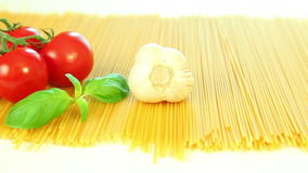 Spaghetti pasta, tomatoes and basil, italian food background stock footage