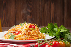 Spaghetti pasta with tomatoes and parsley Stock Photo