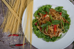 Spaghetti pasta with tomatoes and parsley Royalty Free Stock Photo