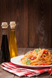 Spaghetti pasta with tomatoes and parsley Royalty Free Stock Image
