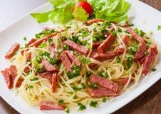 Spaghetti Pasta With Salami Sausage Stock Image