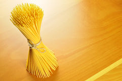 Spaghetti pasta on a wooden chopping board Stock Image