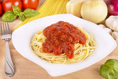 Spaghetti pasta on wooden table. Royalty Free Stock Photography