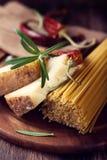 Spaghetti, Pecorino Cheese and Spices Stock Photos