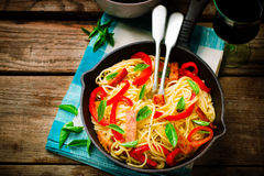 Spaghetti with pepper and ham Stock Photos
