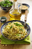 Spaghetti with pesto of arugula. With pine nuts royalty free stock image