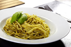 Spaghetti with pesto and basil Royalty Free Stock Photo
