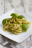 Spaghetti with Pesto and Basil Stock Photo
