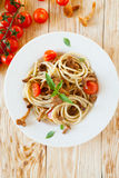 Spaghetti with pesto and cherry tomatoes Royalty Free Stock Image
