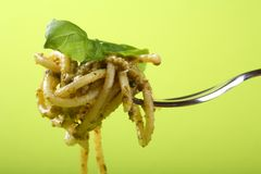 Spaghetti with pesto on fork Stock Images