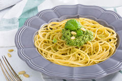 Spaghetti with pesto pine nuts and parmesan cheese basil Stock Photography