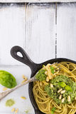 Spaghetti with pesto pine nuts and parmesan cheese basil Royalty Free Stock Images