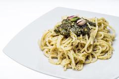 Spaghetti with pesto of pistachios Stock Photo