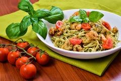 Spaghetti with pesto and prawns Royalty Free Stock Photos
