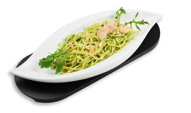 Spaghetti pesto with salmon and arugula Royalty Free Stock Images