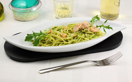 Spaghetti pesto with salmon and arugula Stock Photography