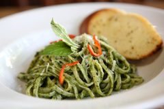 Spaghetti with pesto sauce Royalty Free Stock Photography