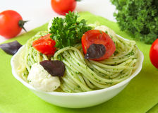 Spaghetti with pesto sauce Stock Photo