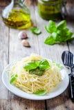 Spaghetti with pesto sauce and basil Royalty Free Stock Photos