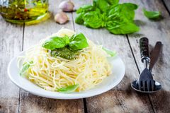 Spaghetti with pesto sauce and basil Royalty Free Stock Image