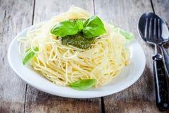 Spaghetti with pesto sauce and basil Stock Image