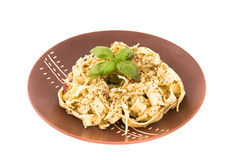 Spaghetti with pesto sauce and cheese Royalty Free Stock Photos