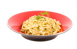 Spaghetti with pesto sauce and cheese Stock Photos