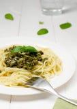 Spaghetti with pesto. Sauce and fresh basil Royalty Free Stock Photography