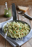 Spaghetti with pesto sauce and toasted peanuts Stock Images