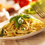 Spaghetti with pesto sauce in warm light Stock Images