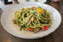 Spaghetti pesto sauce. On wood table at restaurant Stock Photo