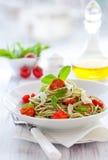 Spaghetti with pesto and tomato royalty free stock photos