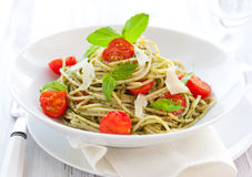 Spaghetti with  pesto and tomato Stock Photo