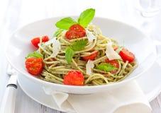 Spaghetti with pesto and tomato stock photo