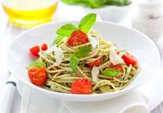 Spaghetti with  pesto and tomato Royalty Free Stock Photo