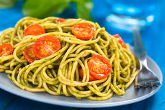 Spaghetti with Pesto and Tomato Stock Images