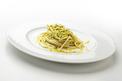 Spaghetti with pistachio and citrus yellowtail Royalty Free Stock Images