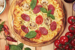 Spaghetti pizza with mushroom and salami Royalty Free Stock Photos