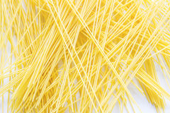 The spaghetti placed severely disrupted. The spaghetti placed severely disrupted and white backgroud stock image