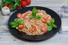 Spaghetti. On a plate with cherry and basil Royalty Free Stock Photos