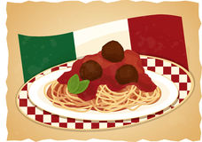 Spaghetti Plate with Italian Flag. A plate of spaghetti pasta with tomato sauce, meatballs, and basil, on a checkered table with an Italian flag in the Stock Photography