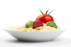 Spaghetti in a plate with tomato, basilikum and sa Stock Image