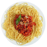 Spaghetti Pomodoro from above. Close-up vertical view of Spaghetti al Pomodoro - spaghetti with tomato and vegetable sauce, topped with grated parmesan - a Royalty Free Stock Images