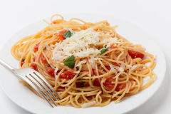 Spaghetti pomodoro and fork. Spaghetti al pomodoro, one of the simplest Italian rustic dishes with the pasta tossed in a sauce of tomato, basil, garlic and a Stock Photos