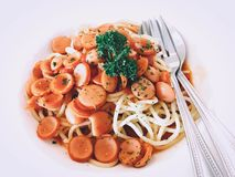 Spaghetti pork sausages tomato sauce. Is a fusion food menu to create a delicious dish with easy cooking ingredients that we can find out in any supermarket Stock Photos