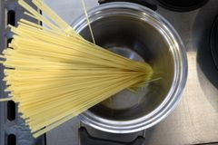 Spaghetti in the pot. From above Royalty Free Stock Photos