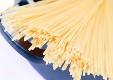 Spaghetti in pot. Close-up italian spaghetti in pot on white background Royalty Free Stock Image