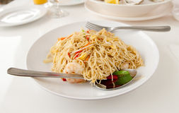 Spaghetti with prawns. On a white plate Royalty Free Stock Photography