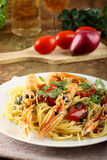 Spaghetti with prawns. On complex background Royalty Free Stock Images