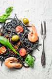 Spaghetti with prawns and black pasta Stock Photography